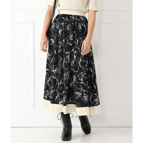 チルのラインフラワーサテン配色スカート。手書きタッチで大人かわいいライン配色フラワースカート。ふんわり広がるフレアで、動くたびに軽やかになびくシルエット。上品な女性らしい印象を与えるミモレ丈も魅力のポイントです。<モデルの身長>163cm※裏地ストレッチあり※裏地あり※ウエスト後ろゴムあり※生地のデザイン上、実際の商品と画像とで柄の配置が異なる場合がございます。予めご了承ください。※商品のお取扱いに関しましては、商品に付属のアテンションカード、洗濯ネームをご覧ください。※モデル着用画像は光の当たり具合で色味が違って見える場合がございます。実物の商品の色味はマネキン着用画像をご参照ください。[型番:0514400043]